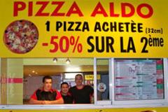 Devanture de la pizzeria Pizza Aldo sur le boulevard Aristide Briand au centre-ville de Perpignan